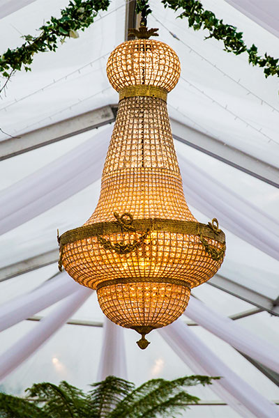 Stunning close-up photo of a 2 meter Empire Chandelier in an outdoor wedding installation