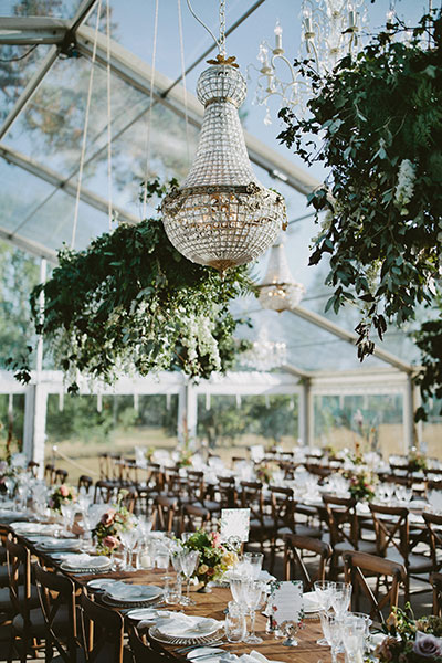 Stunning party setup with 90cm Empire chandelier in an outdoor clear marquee