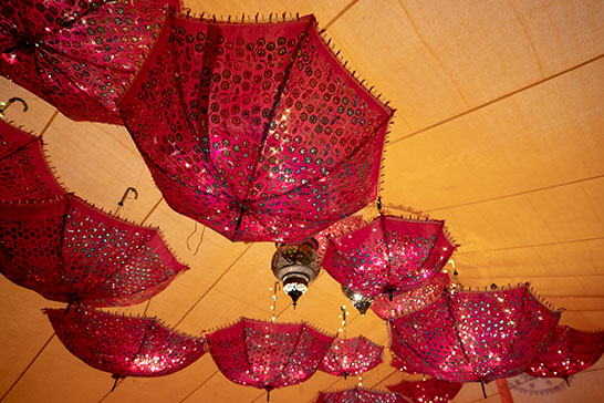 Upside-down umbrella installation at a 21st birthday party in Devon