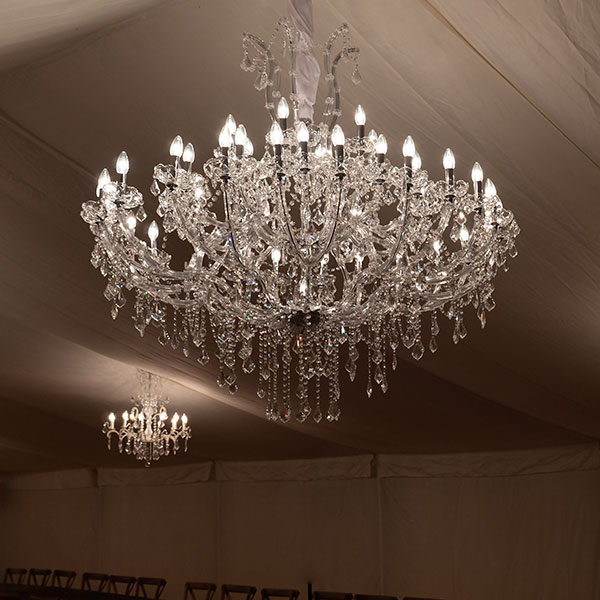 Marie Therese chandelier at Halnaker Park party in a marquee, moody lighting