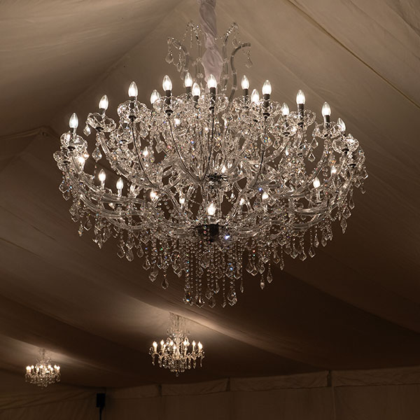 Marie Therese chandelier at Halnaker Park party in a marquee, moody lighting, beautiful effect