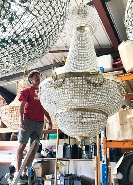 Empire Chandelier stockroom photo with a dude on a ladder for scale