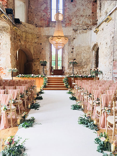 3m Empire Chandelier, event photo in Lulworth Castle, rows of seating and beautiful chandelier hangs as the main feature