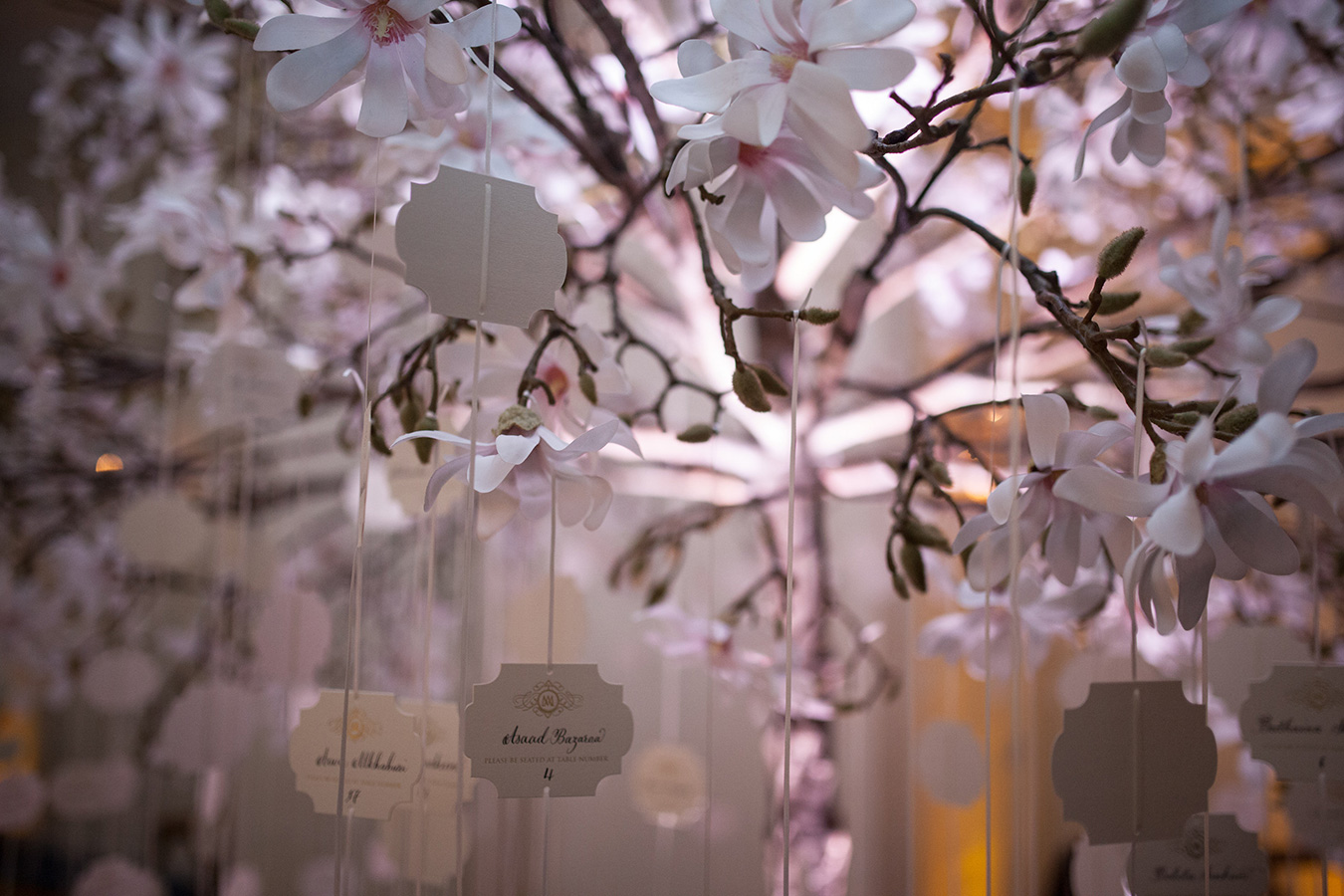 Magnolia tree used for table seating plan at wedding at Oriental Hotel in London