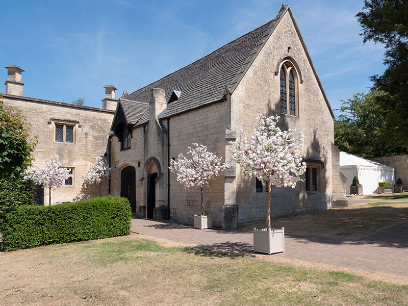 Ellenborough Park chapel with blossom tree walkway