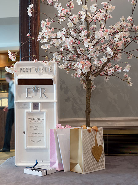 Blossom tree table centres used to decorate wedding postbox