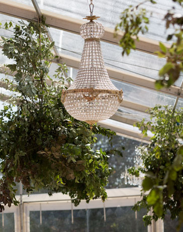 Stunning 90cm Empire chandelier inside a clear marquee at a Suffolk wedding