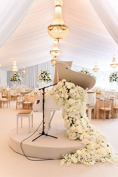 1.65 metre Empire chandeliers at a wedding, available to hire with baby grand piano in the foreground