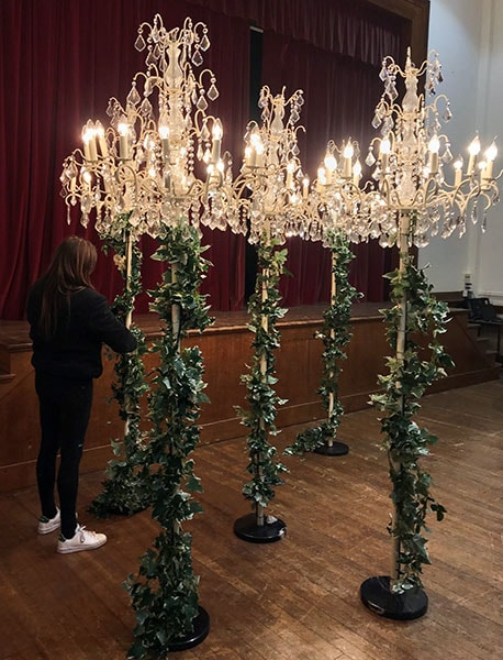 Devon preparing a set of floor standing chandeliers for Christmas hire